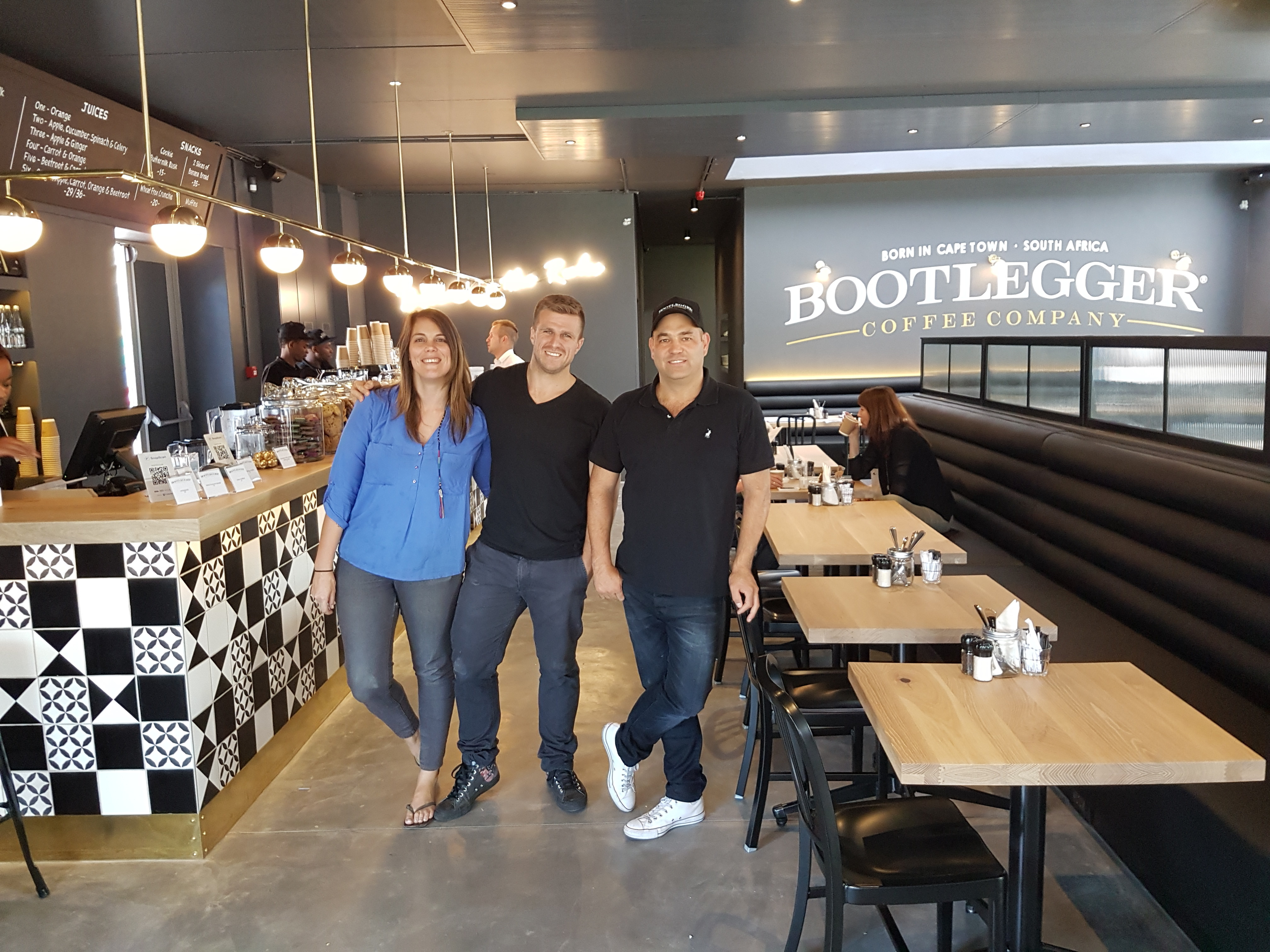 Caption: Talana Wilkinson general manager of Century City Bootlegger with group operations director, Ricky Ruthenberg, and co-founder Pieter Bloem at the new store which opens today.