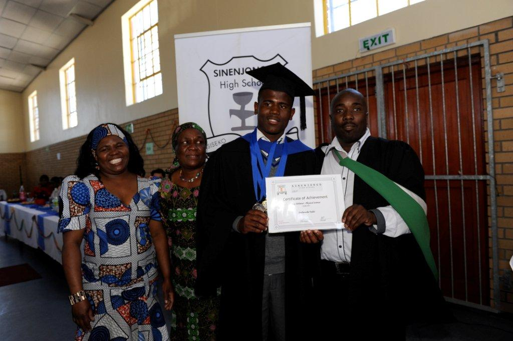 Sinenjongo's top student for this year Simbarashe Fadzi with his proud family